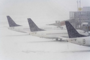Snow causes flight cancellations in northern Europe