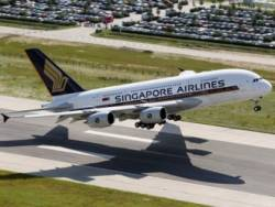 Ajith Says `Encouraged' by Singapore Airlines Results