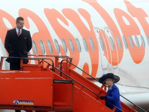 Queen flies easyJet as palace bills soar