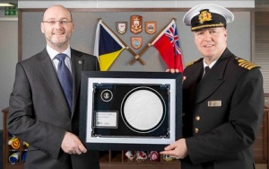 The Royal Mint present new £2 Britannia coin to P&O Cruises captain