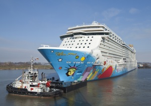 Norwegian Breakaway begins her conveyance along the Ems River