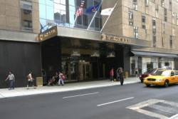 Suspect Charged in New York Hotel Murder
