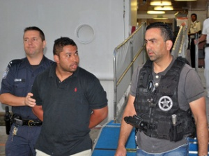 Cruise ends with jail for fugitive