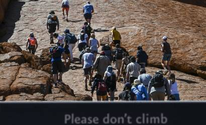 Tourists flock to Uluru as climb ban introduced