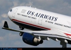 US Airways reports record June load factor