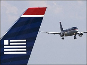 US Airways extends deal with GuestLogix